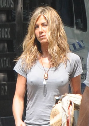Jennifer Aniston stands at attention on set